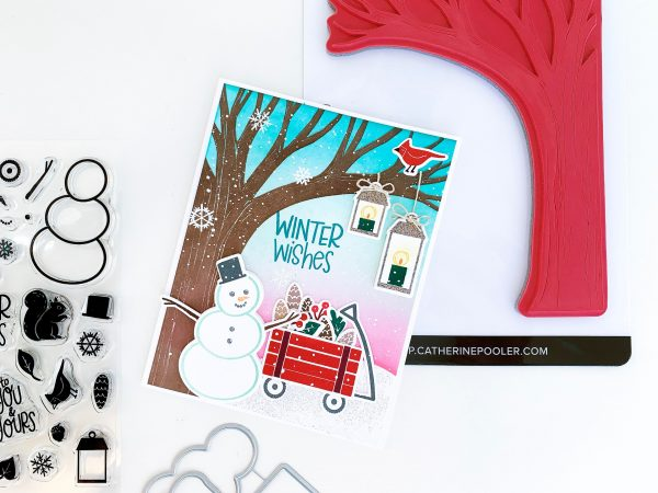winter scene with wagon and snowman