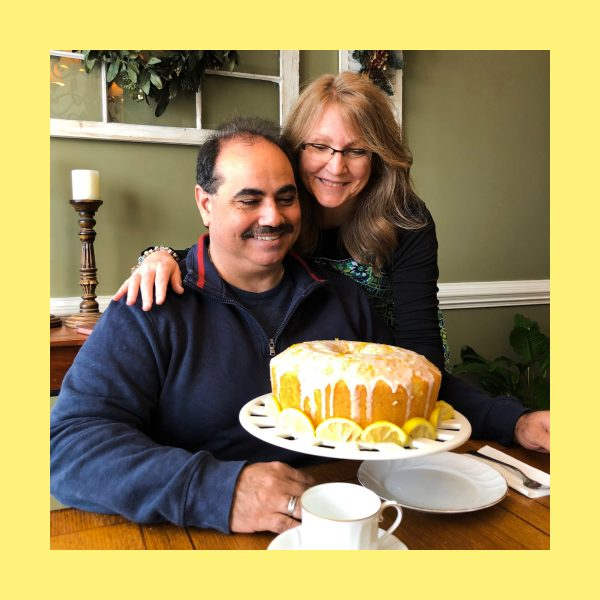 Couple looking at cake with lemons