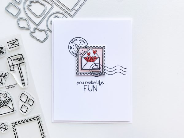 clean and simple card with postage stamp filled with love hearts
