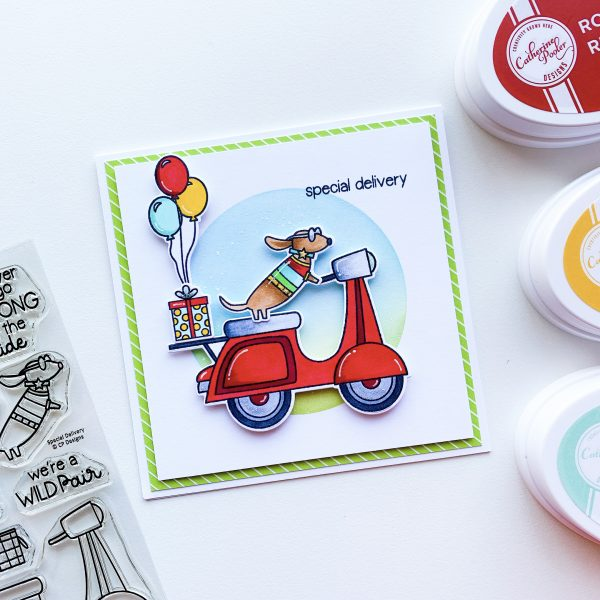 Stamped card with dog on vespa delivering a gift