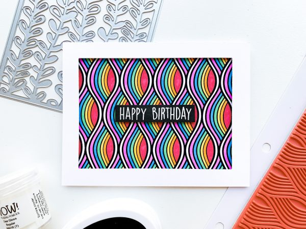 card embossed with rainbow wave background and happy birthday sentiment