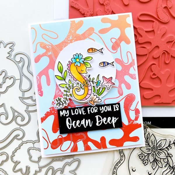 hand stamped card with coral and seahorse images