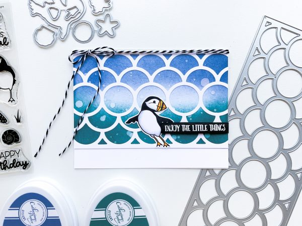 hand made card featuring a puffin image and ink blended background in blues