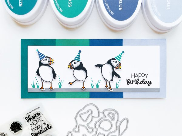slimline hand stamped card with row of stamped puffins in party hats