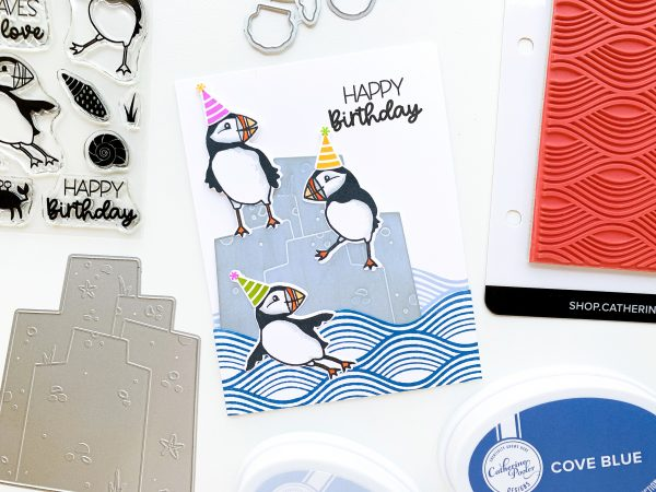 puffins with party hats on a hand stamped card