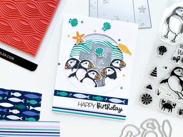 hand stamped card with puffin stamped images and patterned paper