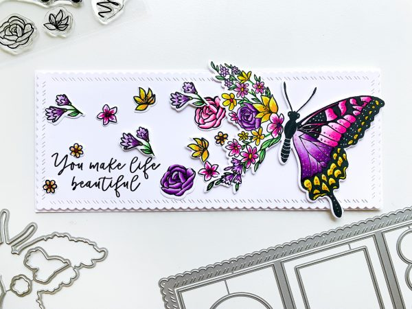 card made with butterfly and floral stamps in slimline layout