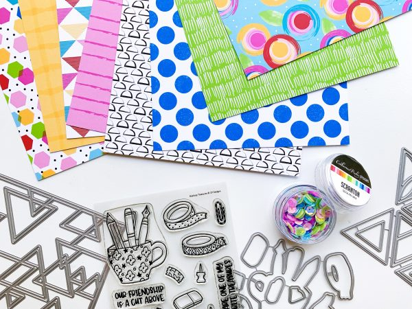 bundle of craft products with bright patterned papers and stationary image stamps