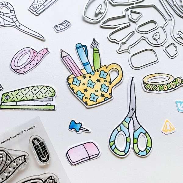 stamped and die cut images of stapler, scissors, mug of pens