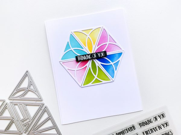 card made with triangle die cut images and bright colored inks