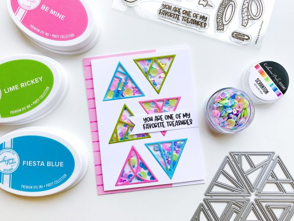handmade shaker card with triangle die cuts and bright neon sequins