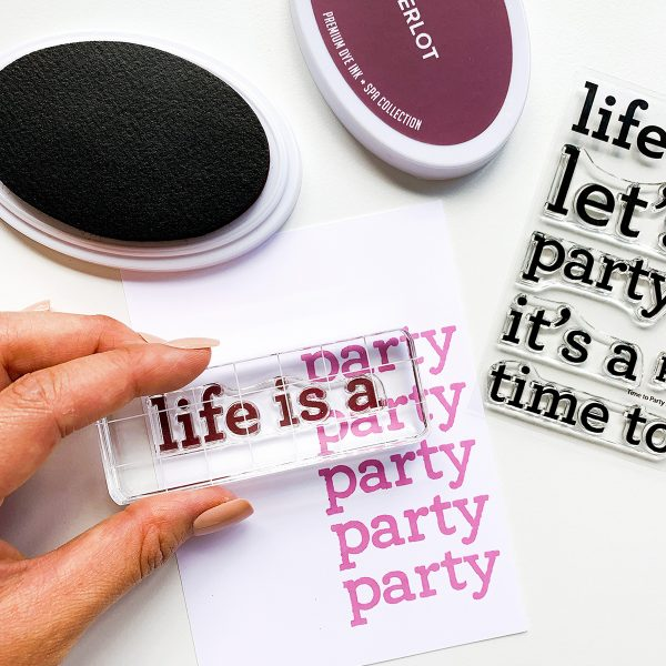 sentiment set of party themed stamps and person stamping words