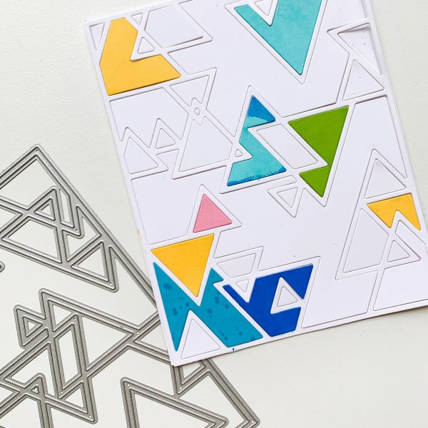 Background on card made with triangle patterned cover plate die
