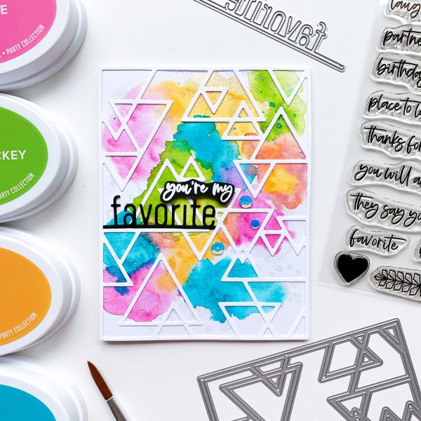 watercolored background on card with cover plate die and favorite word die