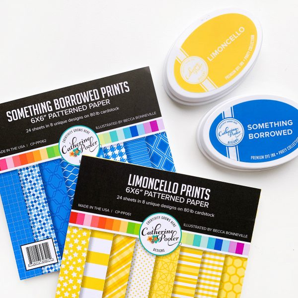 Blue and yellow patterned papers and ink pads