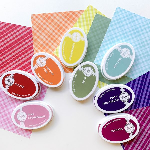 plaid patterned papers in a rainbow of colors with ink pads